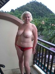See me on my balcony on holiday stripping off and playing with my pussy for all to seeThe guys in the rooms opposite seemed to enjoy the show i put on