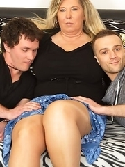 Big breasted BBW taking on two hard cocks