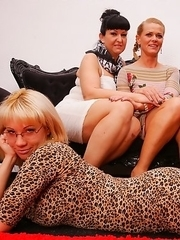 Two housewives sharing one hot lesbian babe